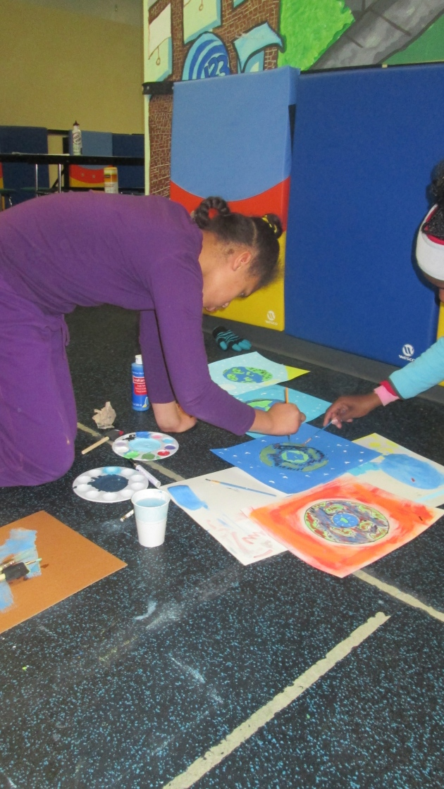"The girls painting ""Our World, Our Future"""
